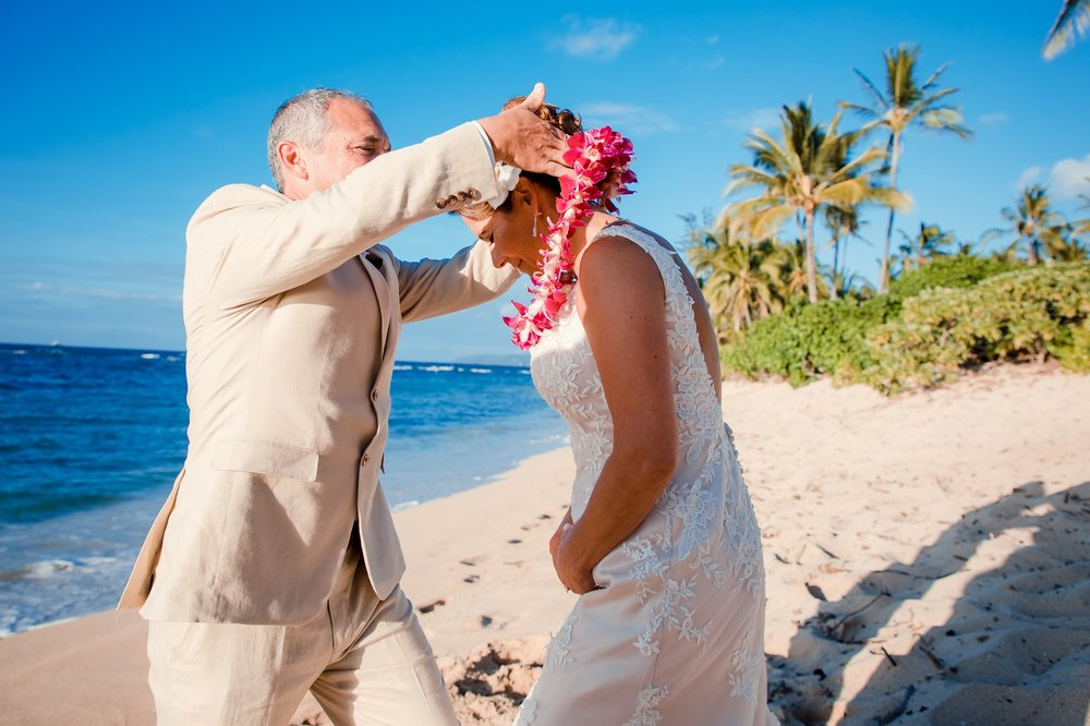 exchanging leis in Hawaii wedding beach ceremony