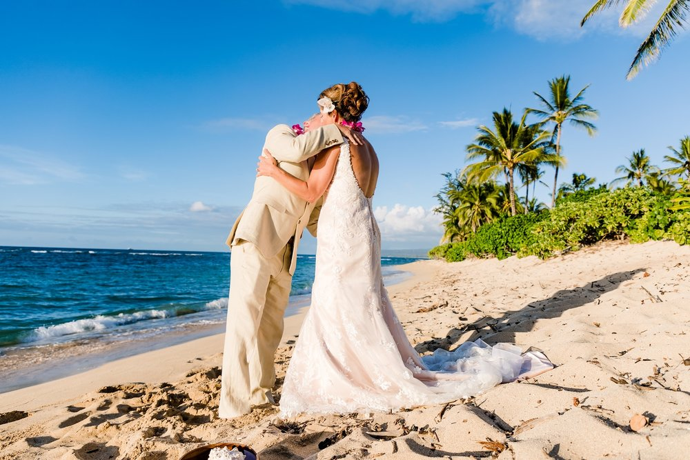 wedding kiss of bride and groom haleiwa hawaii