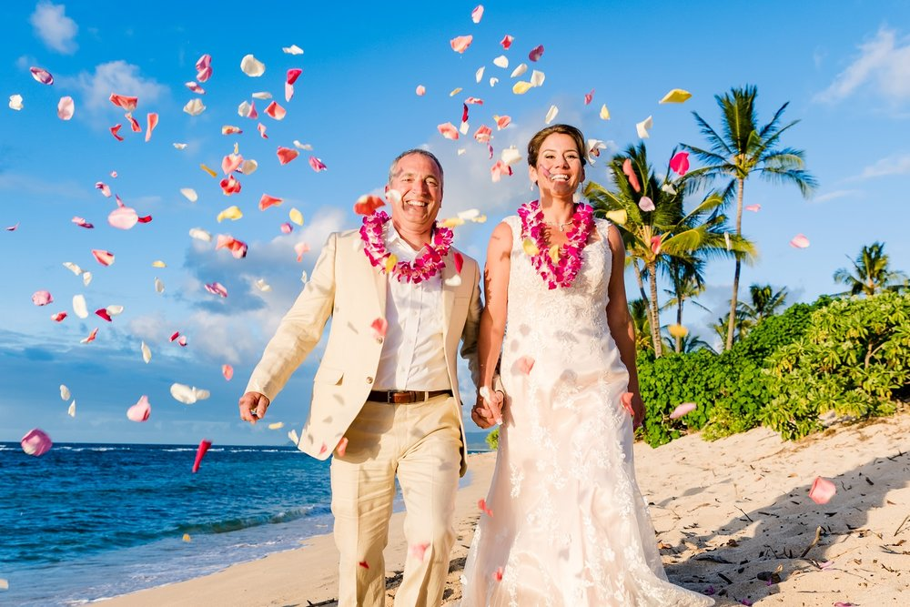 wedding kiss flower toss beach ceremony