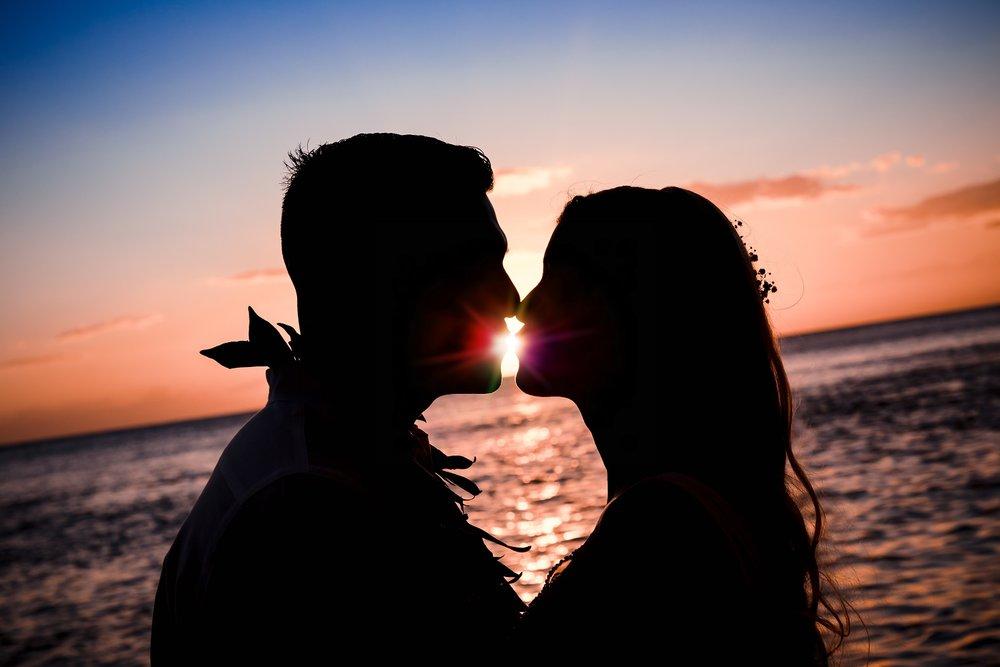 sunset wedding ceremony silhouette