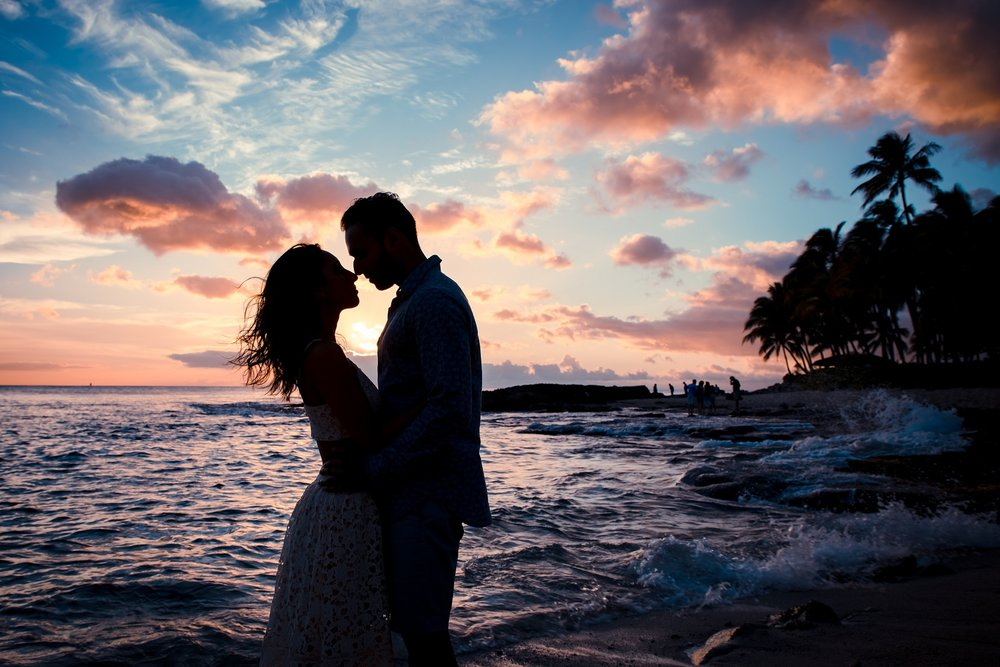 sunset silhouette portrait of couples surprise proposal