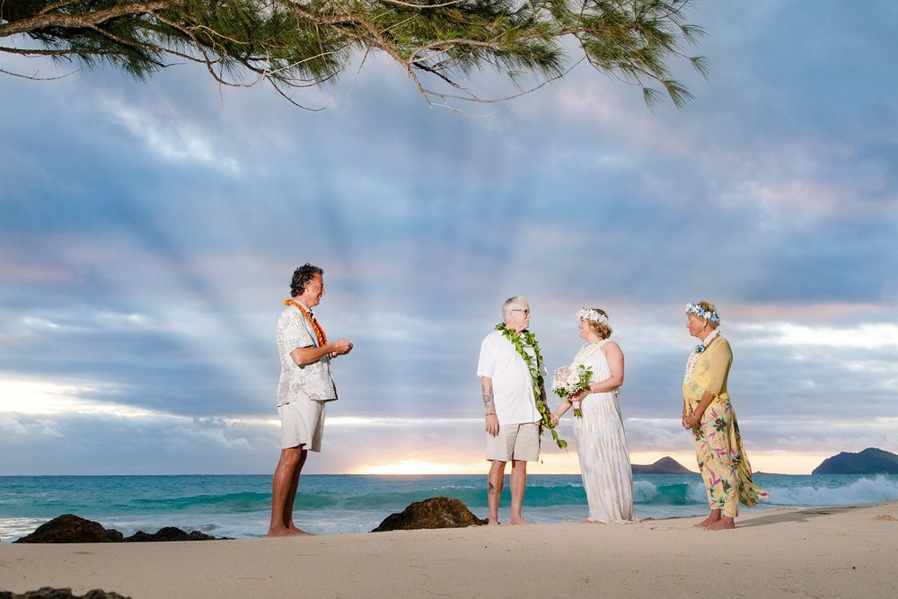 Sunrise beach wedding ceremony at Bellow's Air Force base