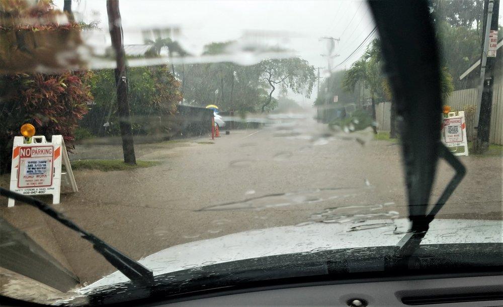 heavy rainstorm water on roadway