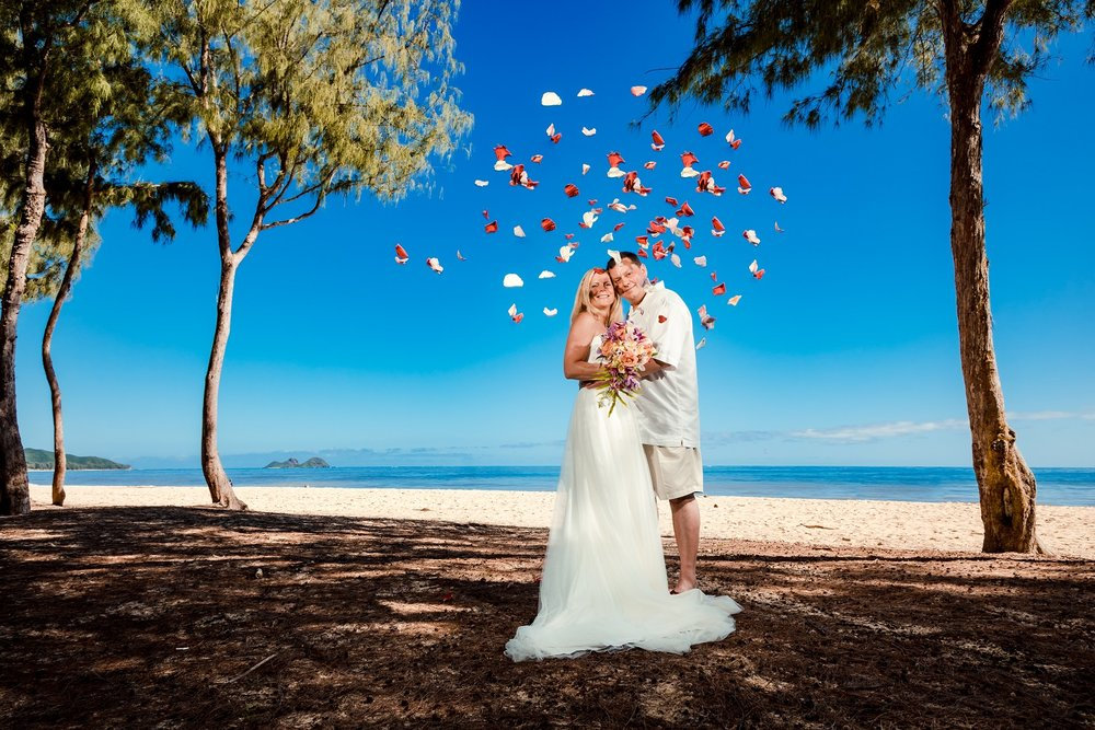 hawaiian wedding portrait flower petal shower beach oahu