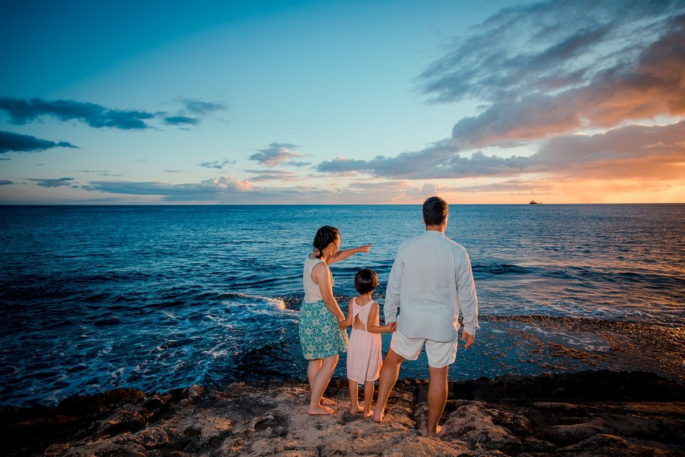 sunset on oahu's north shore with family photo