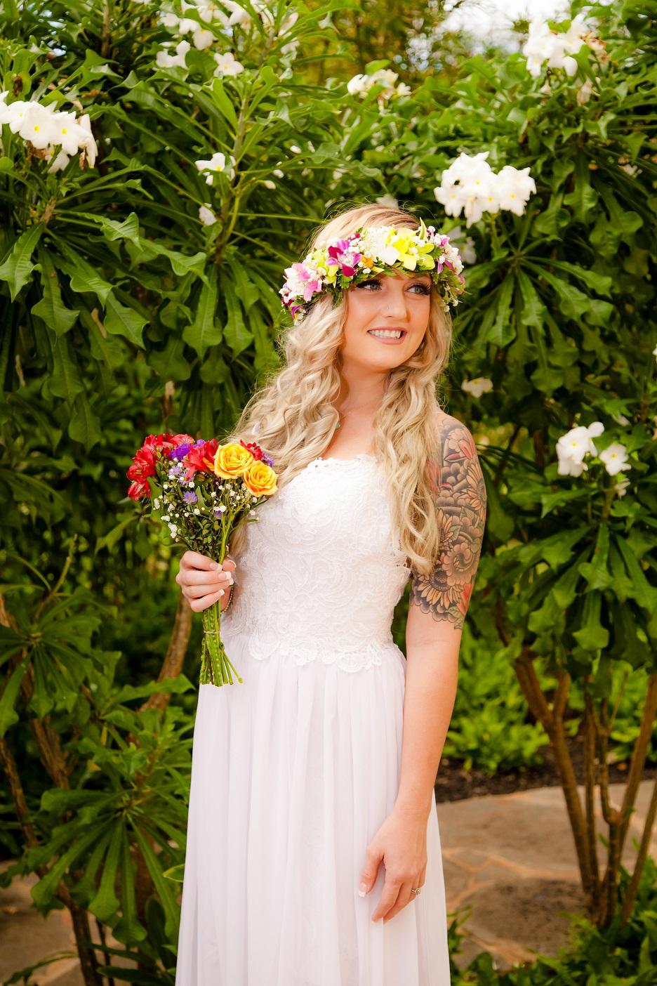 bride and wedding dress flowers in hawaii garden