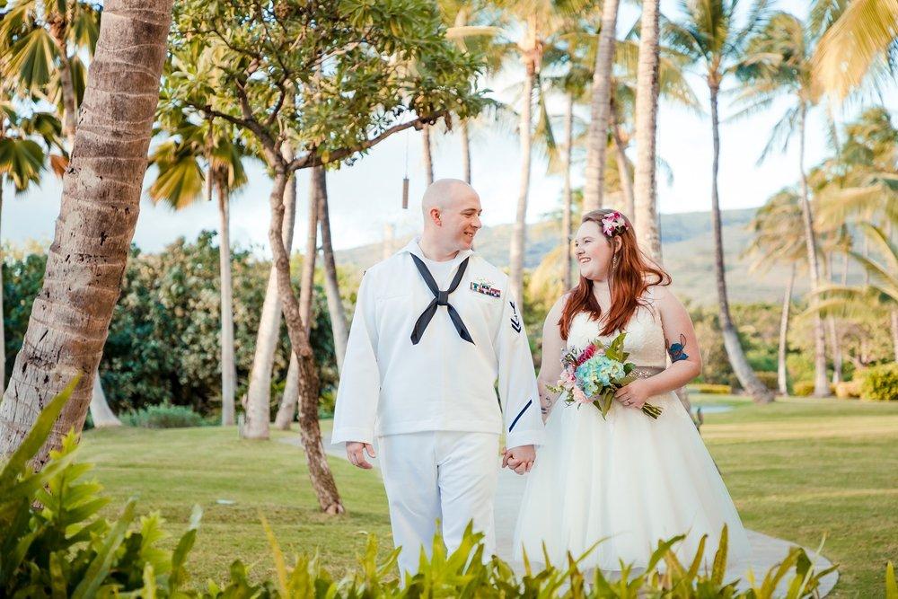 sailor groom and bride at four season resort oahu
