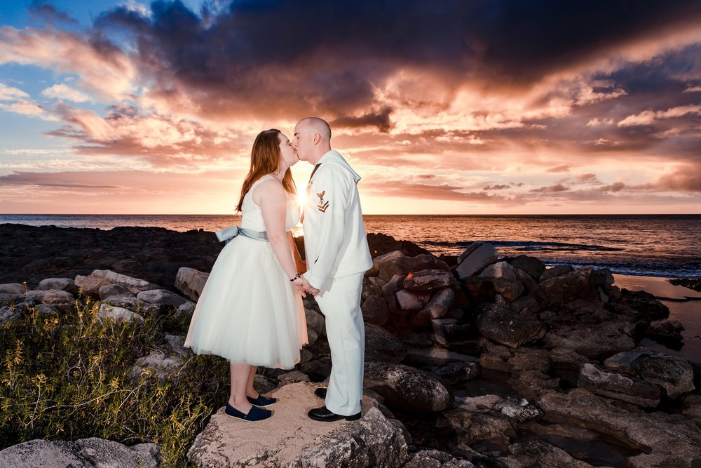 bride and groom sunset beach wedding kiss oahu hawaii