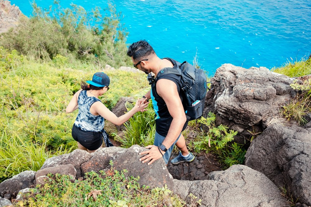 couple hiking makapuu after engagement photo session