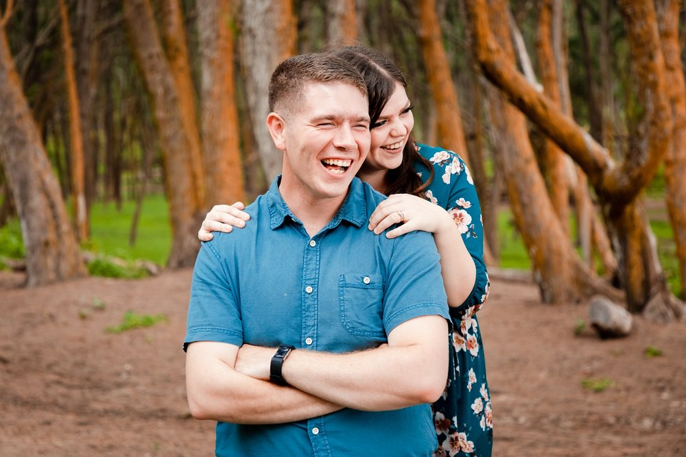 hawaii couples candid portrait in forest