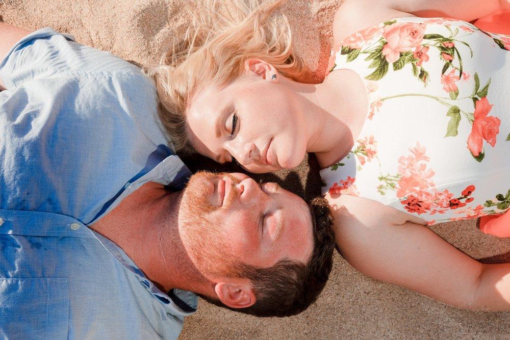 Sweet honeymoon portrait on the beach at sunset