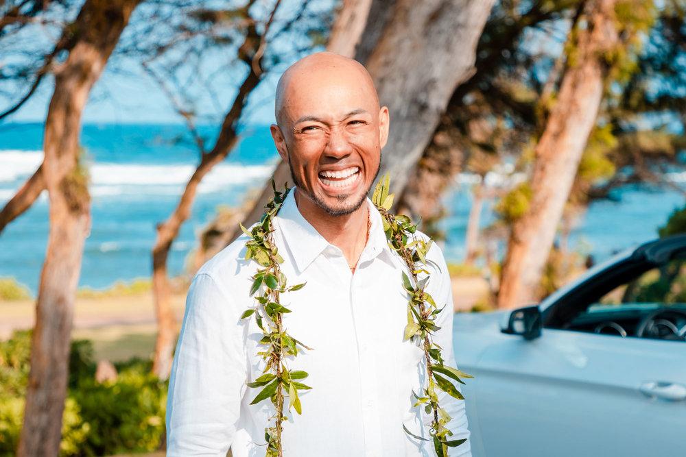 kauai elopement groom laughing