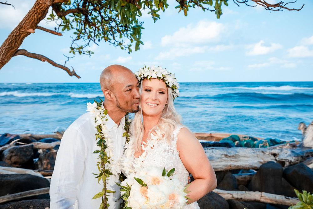bride and groom on beach kauai elopement