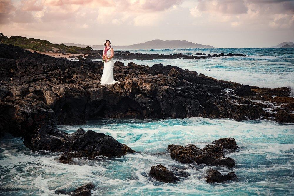 bride on rocky ocean shore kauai hawaii