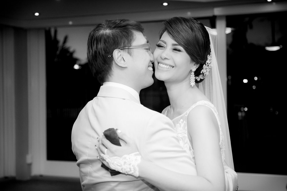 bride and groom wedding reception in black and white