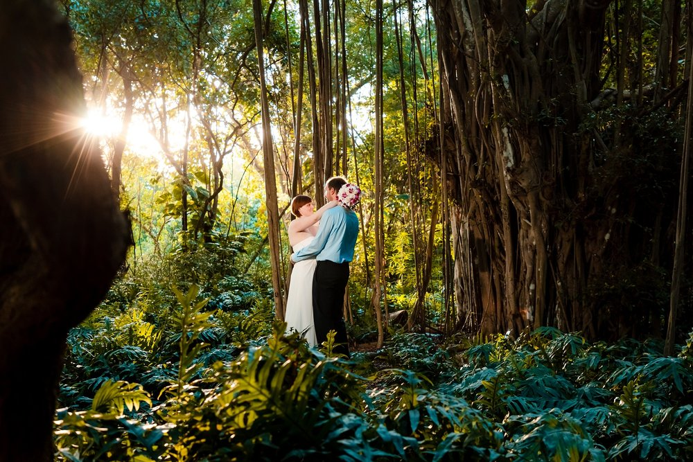 bride and groom wedding portrait in maui forest