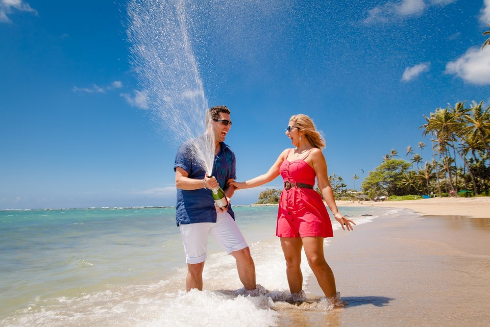 champagne pop couple honeymoon celebration beach portrait