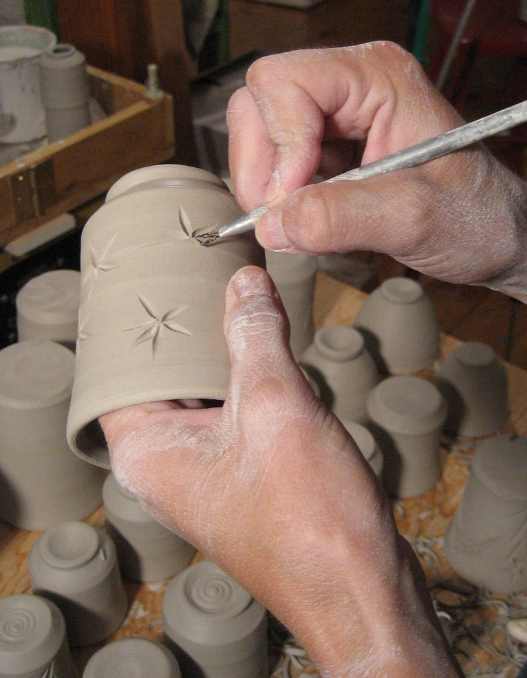 Amy_Clark_Ocean_Fire_Pottery_carving.jpg