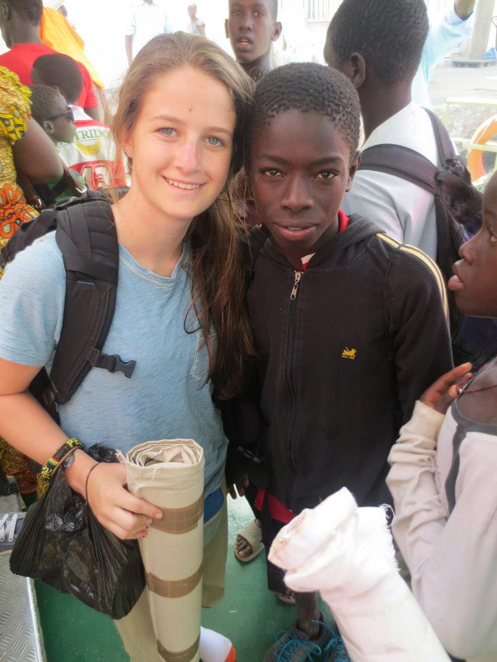 Me in Senegal with my buddy named Ibou. In this picture, he is wearing the sneakers I gave him.