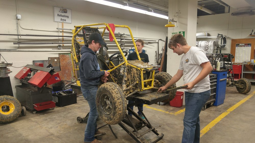 Mitch Evens (left), Kayla Denson, Eric Jones assembling Car 88 for the UI Homecoming Parade