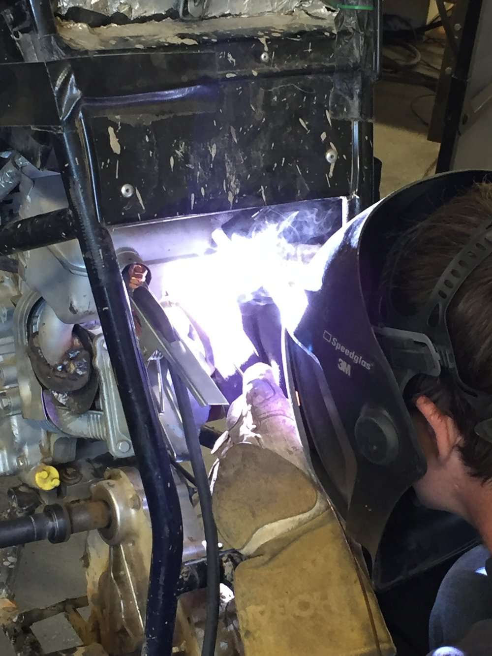Mitch Evens welding the exhaust to Car 48