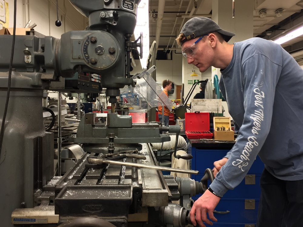 Ryan Long milling a component for the Steering Subsystem