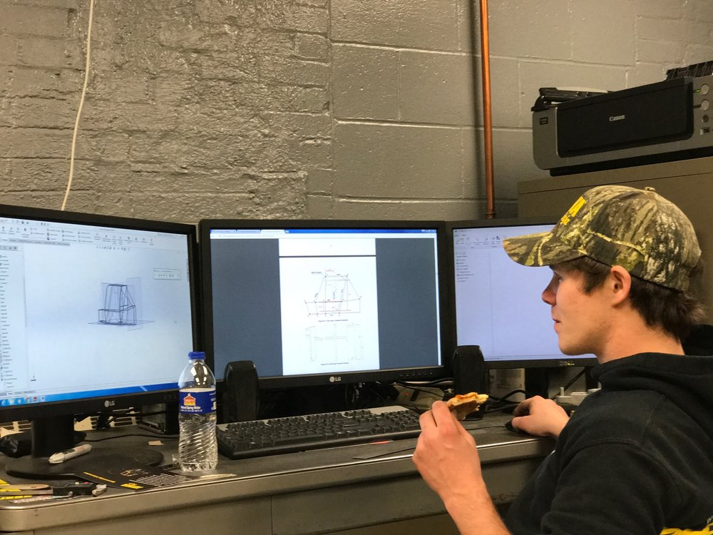 Designer Mitch Evens verifying the frame conforms to SAE Regulations
