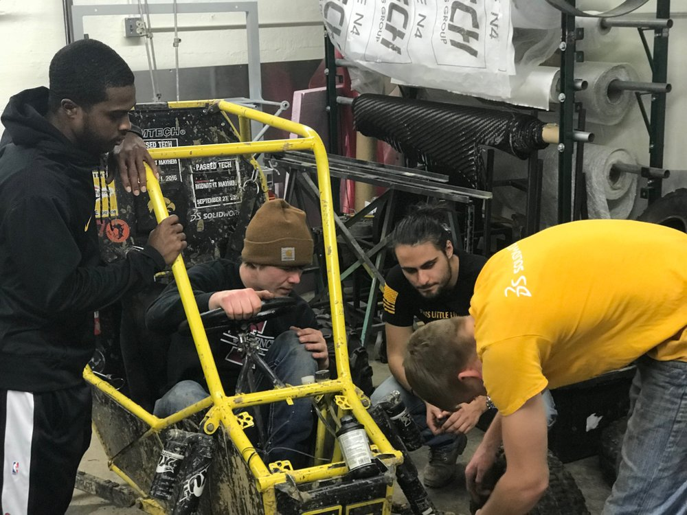 (From Left) Martell Bell, Mitchell Evens, Grant Schelley, and Rob Pohren Bleed Brakes on one of the Baja Vehicles