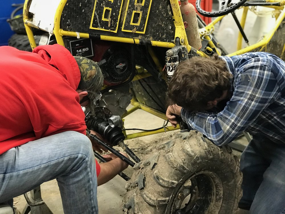 Spencer Van Dorn and Jacob Koke tightening bolts on Car #88