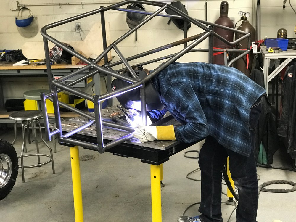 Sam Berry welding together the frame for the nationals car.