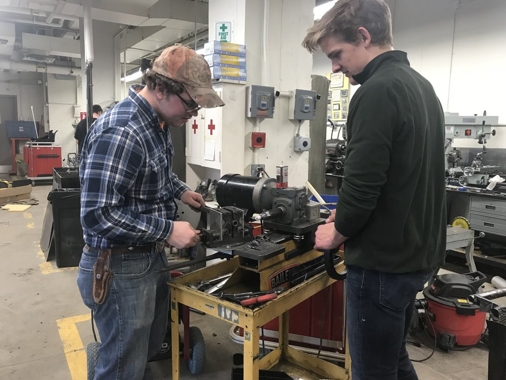 Jacob Koke (left) and Peter Laubenthal (right) fabricating the new A-arms.