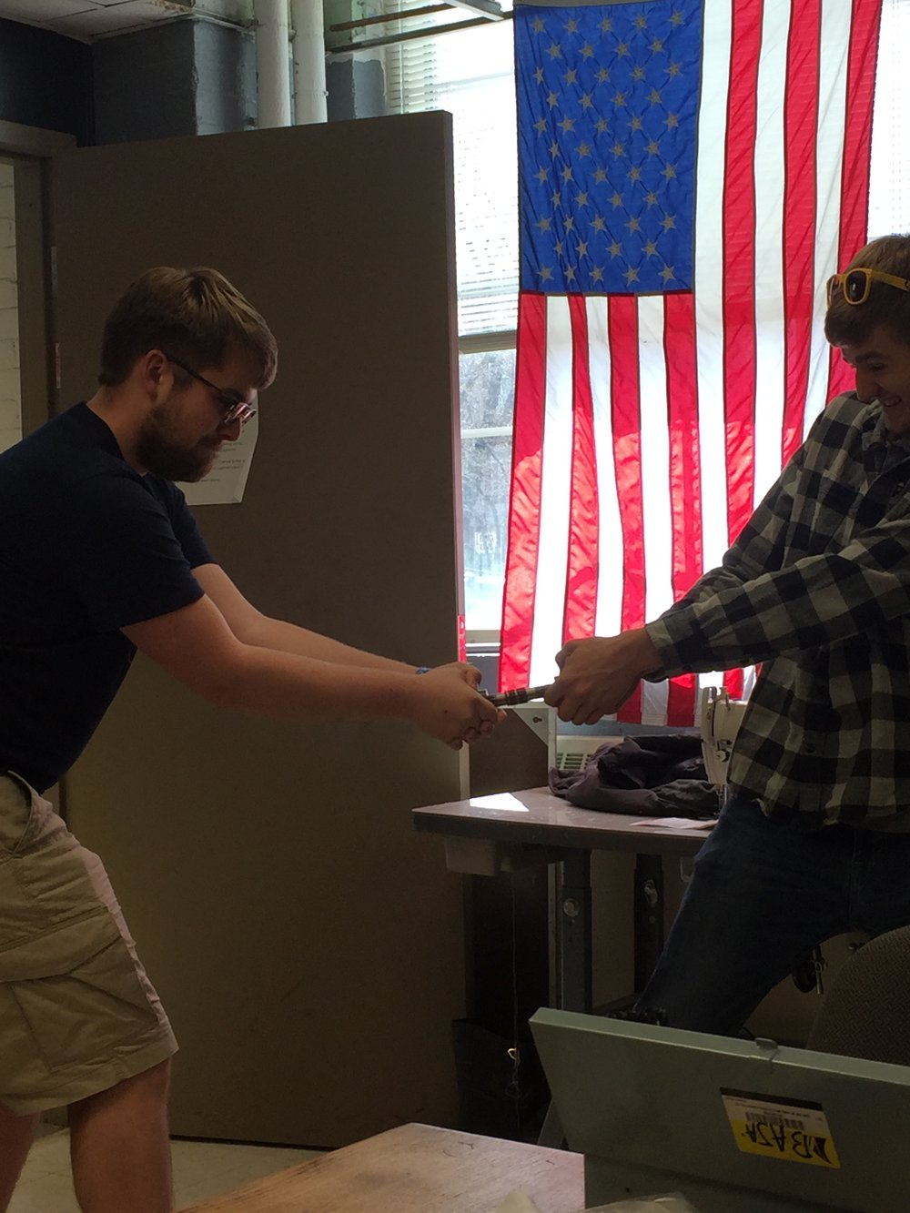 Secretary Eric Jones and Vice President Rob Pohren checking strength of a part