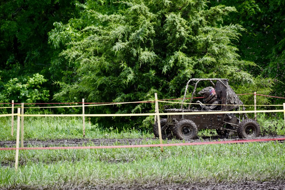 Driver Mitch Evens, covered in mud, back on the track after the first gear box issue.