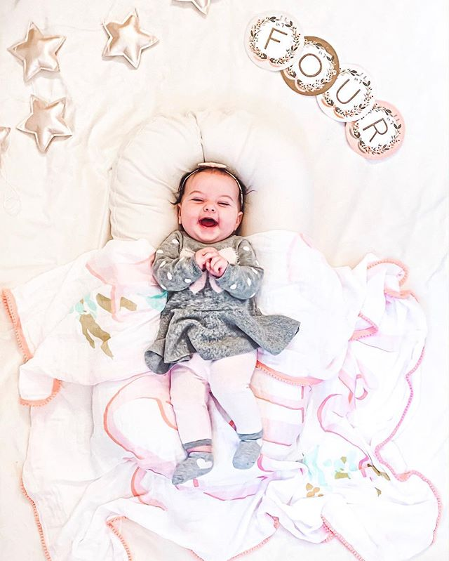 4 months (+2 days!) with our smiley Noa Ella 💕 So much has happened in the last month! Noa played in the snow for the first time and took her first trip abroad. ❄️ She was a pro traveler and managed to fall asleep on both plane rides to Mexico. ✈️ She has been missing the poolside cocktails she became accustomed to. 🍹 She also spent her first night away from mama and papa and did great while on her grandparents' watch! Noa's becoming much more interactive - she loves reaching and grabbing whatever is in sight and tries to put everything in her mouth - especially her hands (and occasionally Adina's fingers.) 🤤 At her last doctor appointment, she weighed in at 14 lbs 11.1 oz (42%) and 25 inches (74%) and impressed the doc by rolling from her belly onto her back. Soon she'll be on the move!  We love you, Noa girl! 💖