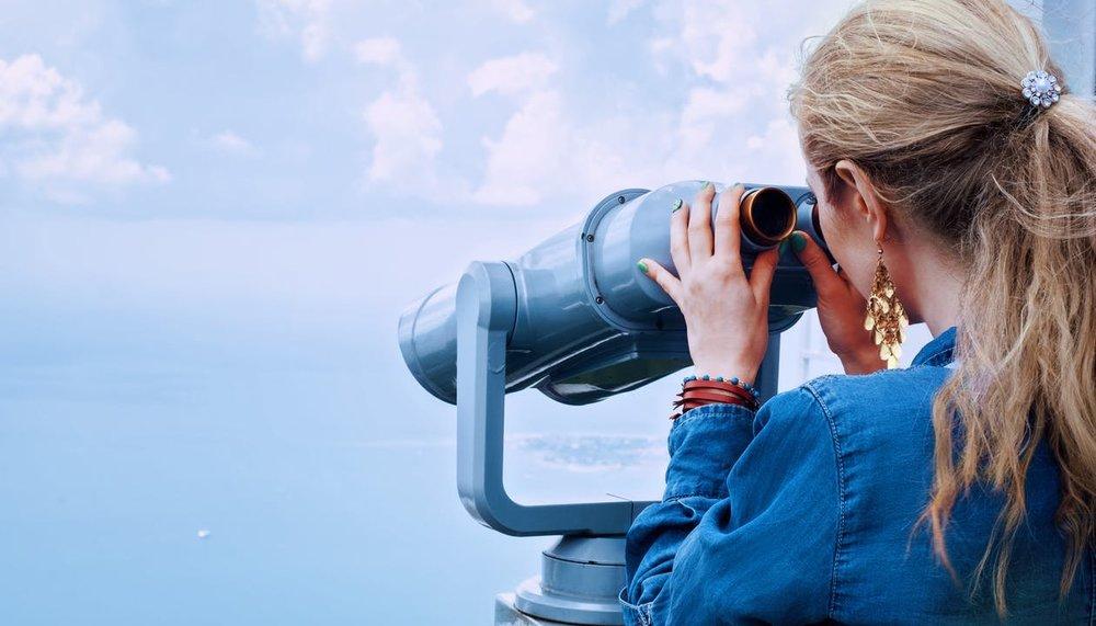 girl-sea-binoculars-vacation-160514.jpeg