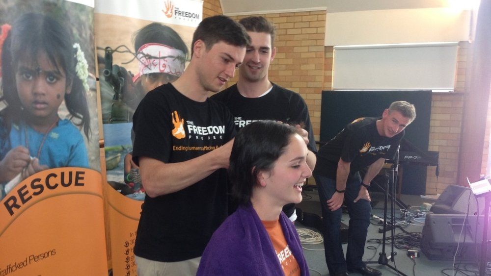 Getting her head shaved to raise funds for The Freedom Project