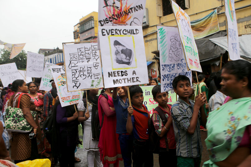 Sex workers and their children take part in an demonstration in 2014 seeking better rights and a halt to girl trafficking in the red-light area of Kolkata, India.   Photo Credit: CNS photo/Pial Adhikary, EPA