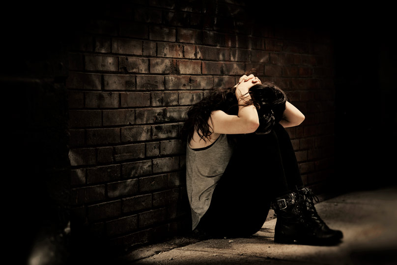 This photo illustration of a woman depicts the effects of sex trafficking and the despair its victims often say they feel.  Photo Credit: CNS photo/Lisa Johnston, St. Louis Review