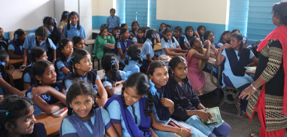 Girls at a local school receiving community education on the risks of exploitation.