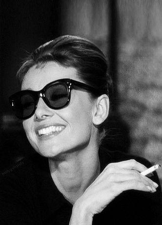 Audrey Hepburn taking a load off