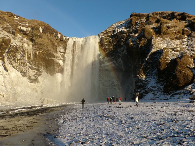 The hubby's beloved Skógafoss waterfall and that rainbow just showed up during our visit.elH