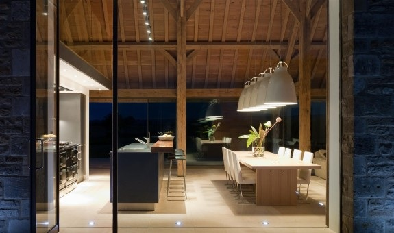 A whole wall of glass has been added to this barn conversion which, with a mixture of clever lighting design, dramatically showcases the salvaged structure and contemporary interiors. Stow On The Wold