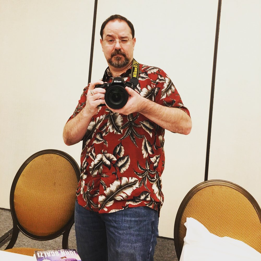 I had a camera face-off with John Scalzi - his Nikon DSLR vs. my iPhone 6S Plus. Notice his conveniently placed copy of his forthcoming novel, The Collapsing Empire...