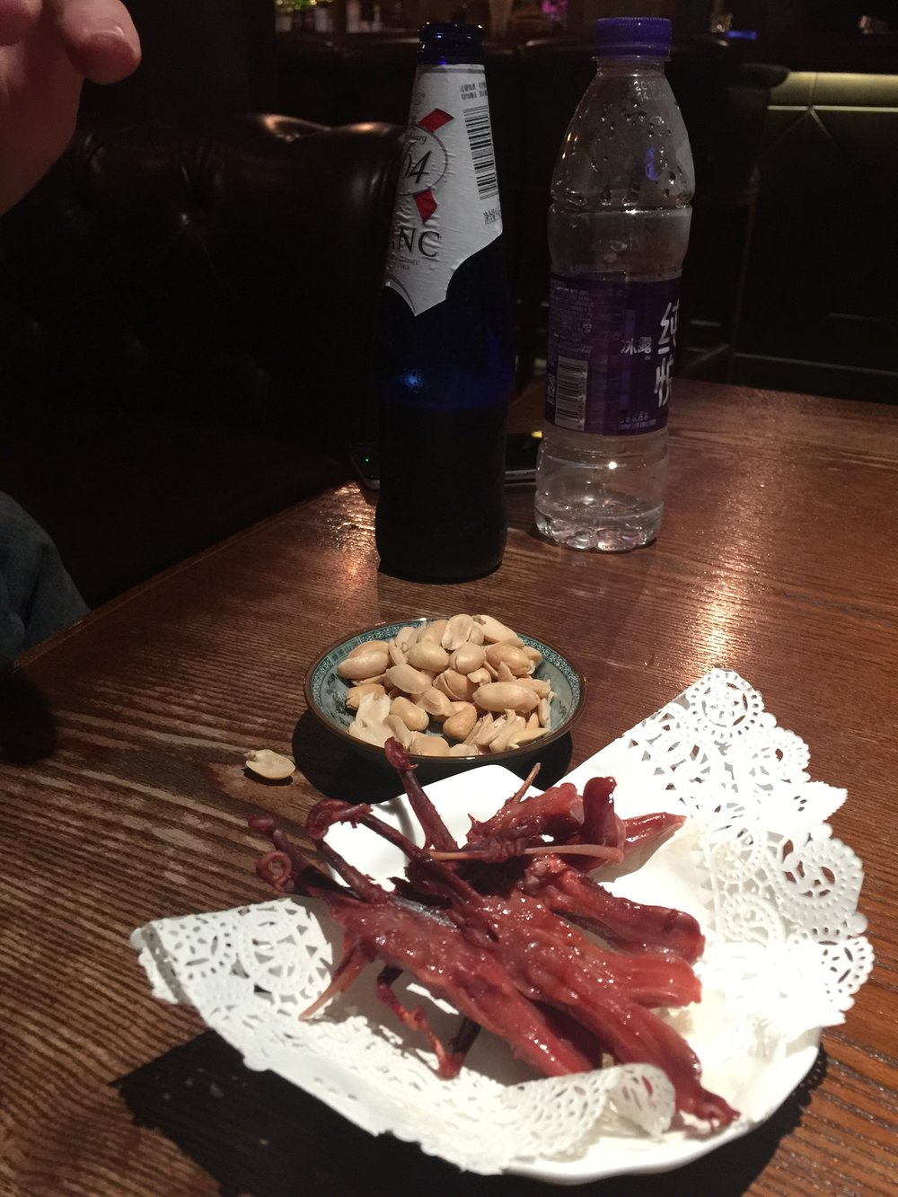Beer, peanuts and duck tongues. Yep duck tongues.