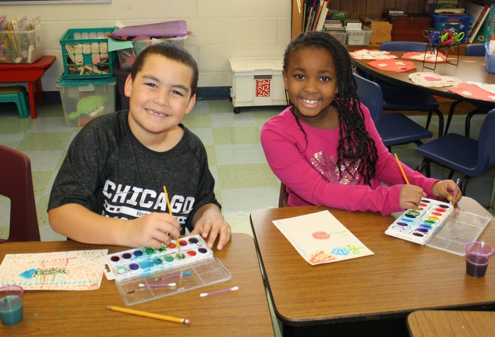Two students painting.JPG