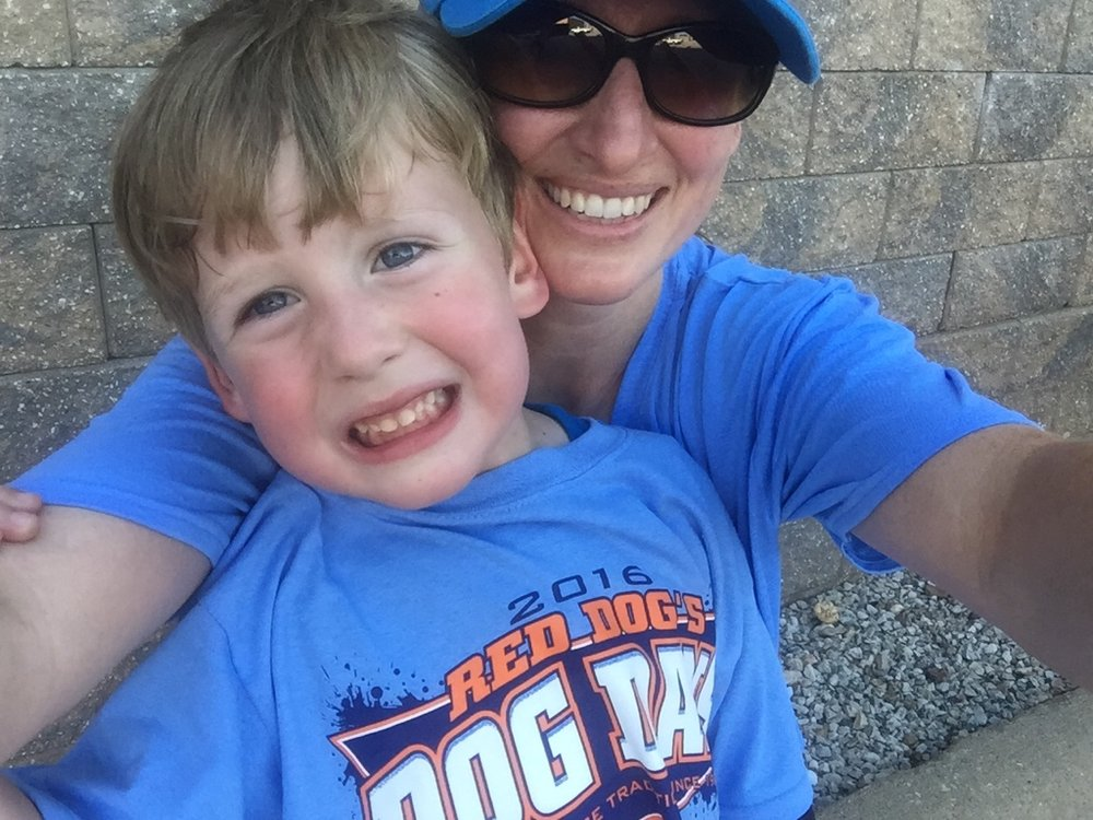 My son and I posing in our Lawrence, Kansas Dog Days T-shirts. We earned the shirts after completing 25 workouts this summer!