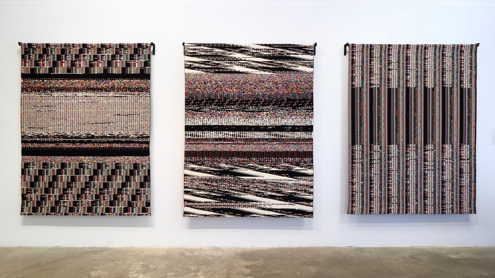 Stearns' Fragmented Memory tapestries on display.
