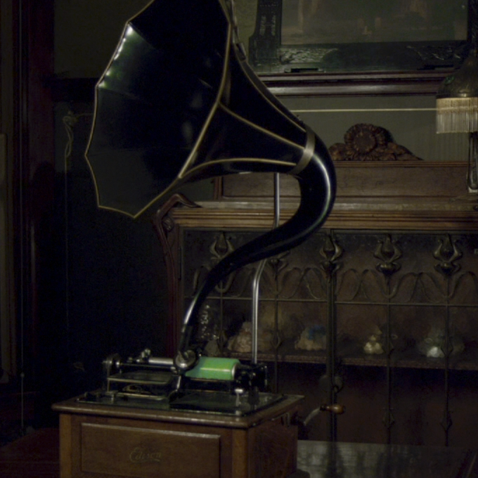 "Glow-in-the-dark wax cylinder recording of ""Welcome to My Nightmare"" played on a phonograph."
