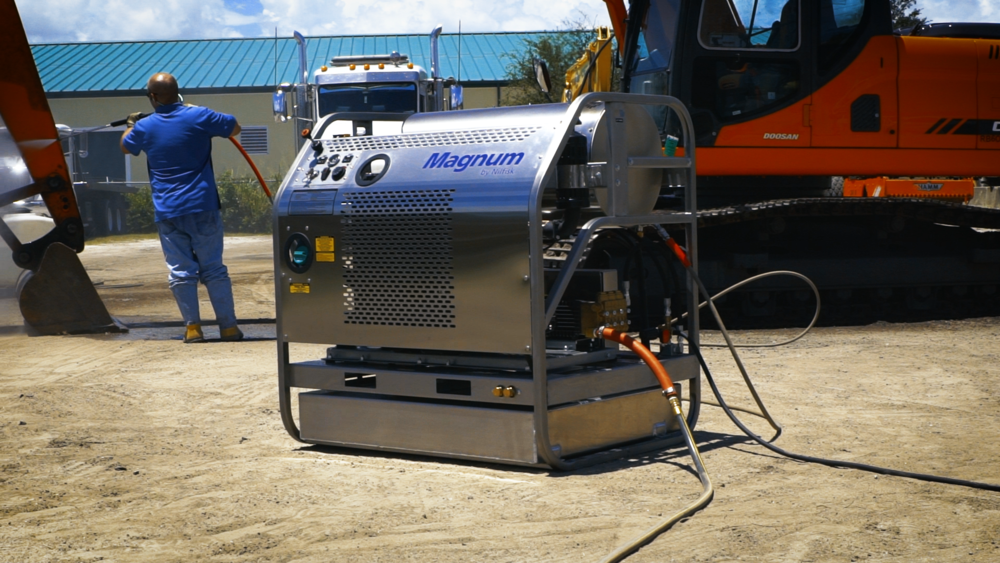 The Magnum Diesel Hot Water Pressure Washer by Nilfisk in the field cleaning heavy equipment