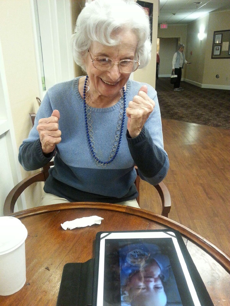 A picture of mom watching a story about her greatgrandson.
